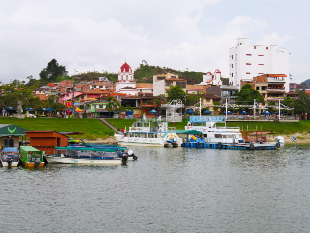 Boats on the lake in the town of Guatape, Colombia