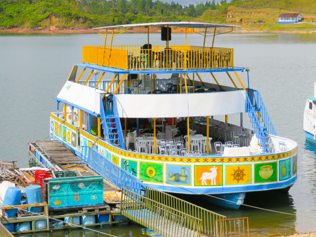 A colourful boat used for cruises on the lake in Guatape, Colombia.