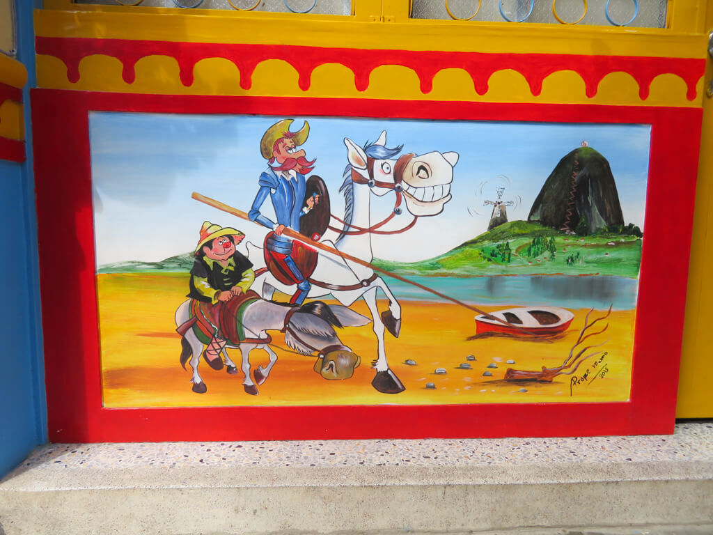 A cartoonish zocalo on a house in Guatape, Colombia