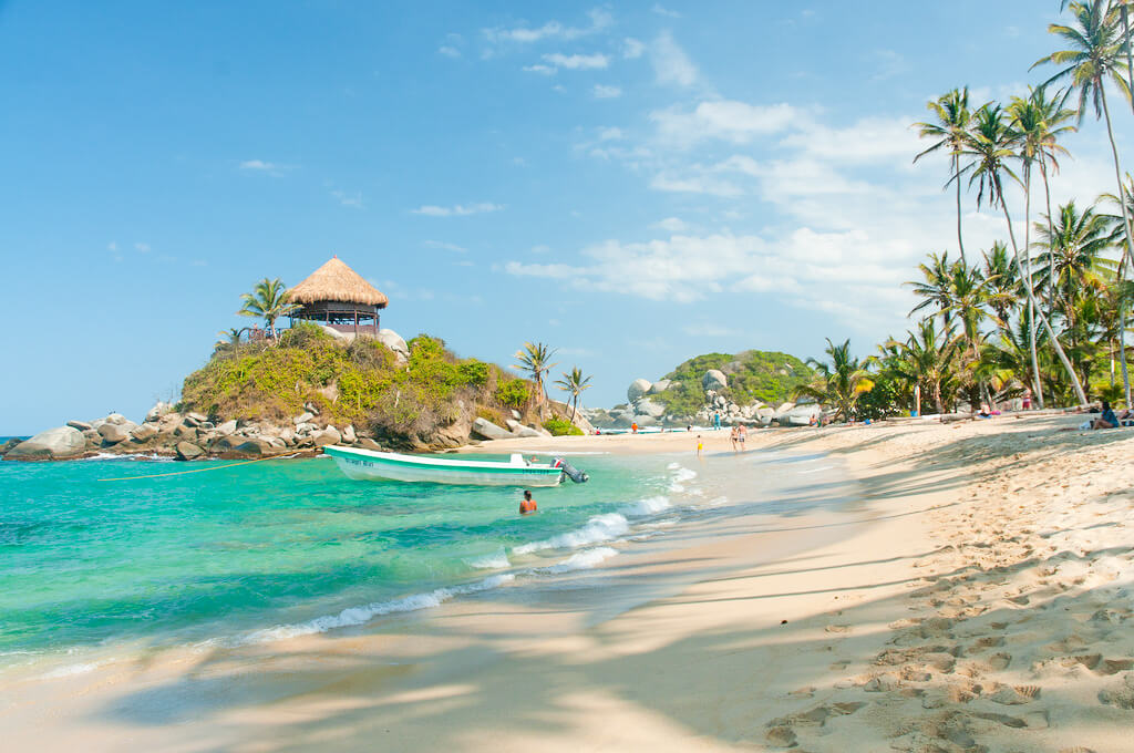 The sandy beach an sparkling blue waters of Tayrona National Park, Colombia