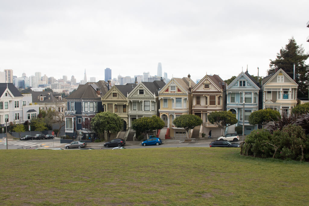 The famous Painted Ladies houses from the TV show Full House as seen from Alamo Square Park