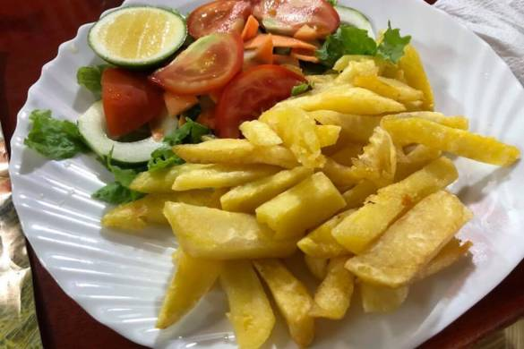 French fries and salad served with fish at El Descanso Marinero restaurant on San Cristobal Island