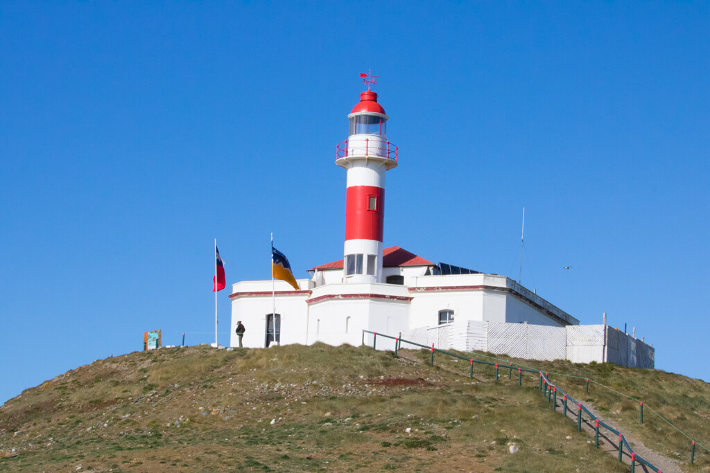 The red and white lighthouse on Isla Magdalena