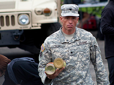 Ruck marcher helping with food donations