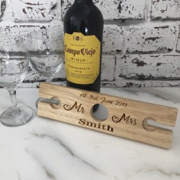 This unique Wine Glass & Bottle Butler makes a wonderful personalised gift for any occasion. The wooden wine butler balances on a wine bottle and holds 2 stem glasses. This unique product makes a great birthday gift, anniversary present or personalised wedding gift.