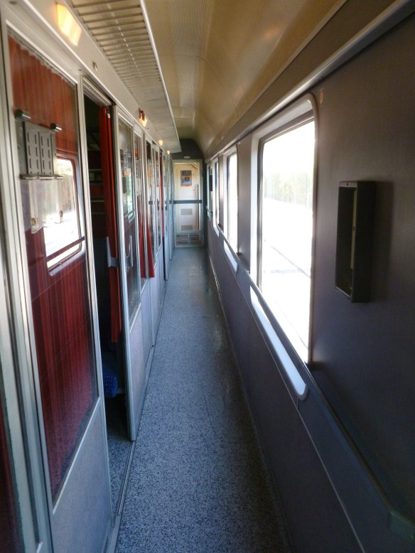 Inside the first class car looking towards the back of the passer car.