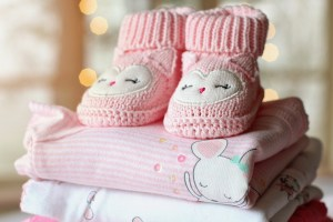 Create a baby keepsake by making a memory quilt from your child's baby clothes