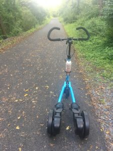 Blue Me-Mover on Ironton Rail Trail in damp conditions with light cover of leaves
