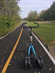 Blue Me-Mover looking down a freshly paved rail trail