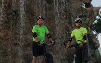Riders Tom Case and Humberto Perez on their Me-Movers in front of a waterfall