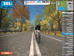 Zwift screenshot of white bicycle riding through Central Park.