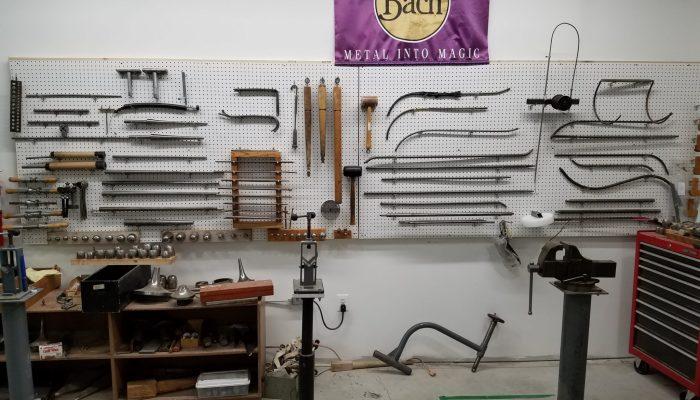 Band repair tools hanging on wall.
