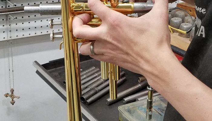 Brass trumpet in the process of having its valves repaired.