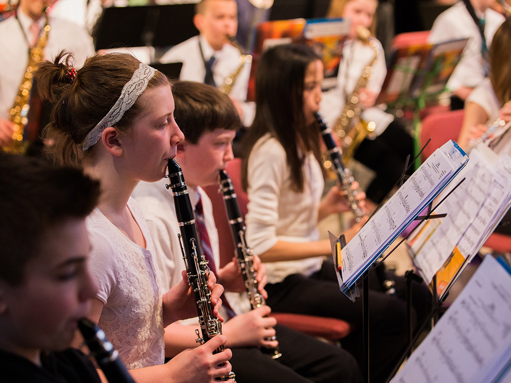 Student musicians playing in a concert band.