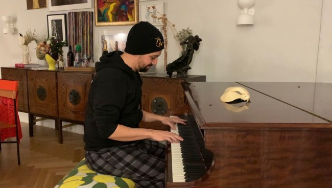 Lin-Manuel Miranda plays piano in his NYC apartment.