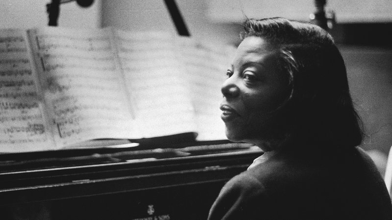 Mary Lou WIlliams sits at her piano.