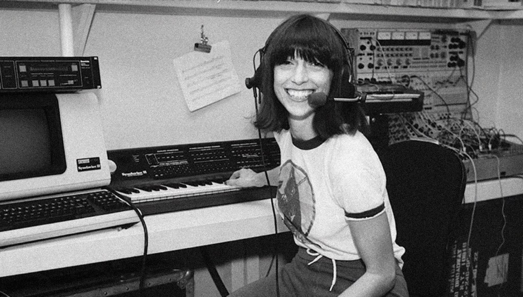 Suzanne in front of the keyboard in her studio.
