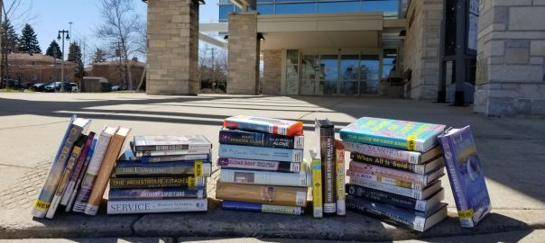 stacks of books on a curb