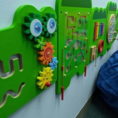wall mounted green muti-sensory activity board