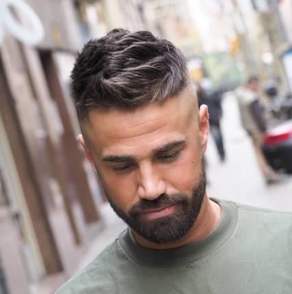Medium textured haircut for guys and high bald fade