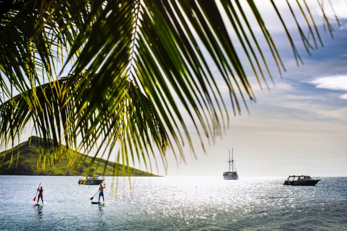 Standup paddleboarders at VoliVoli Beach Resort, Suncoast, Rakiraki, Fiji