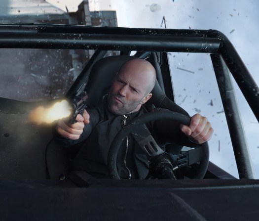 "Deckard Shaw (Jason Statham) in a custom rock crawler, based on the Land Rover Defender 110, in ""Hobbs & Shaw"""