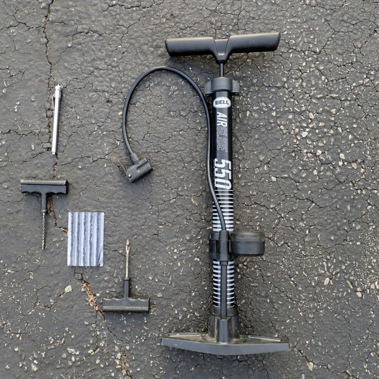 Tire pressure gauge, plug kit, pump.
