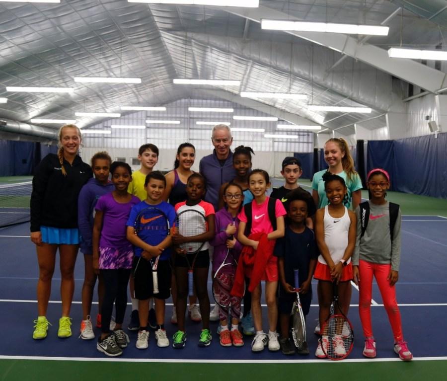 John McEnroe and youth tennis players at John McEnroe Tennis Academy