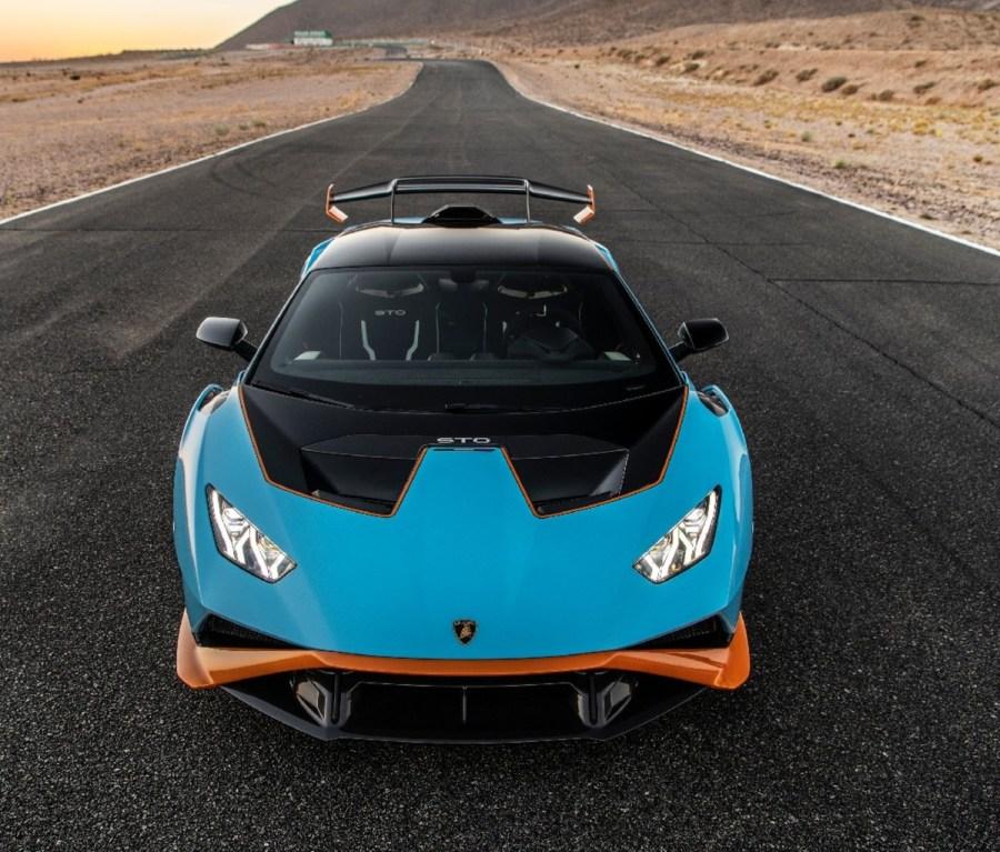 Front angle of blue 2021 Lamborghini Huracán STO on a race track