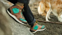 Man wearing green and brown men's boots with a dog in the background
