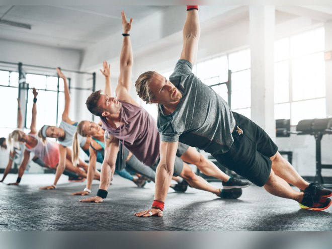 Group fitness class doing side plank