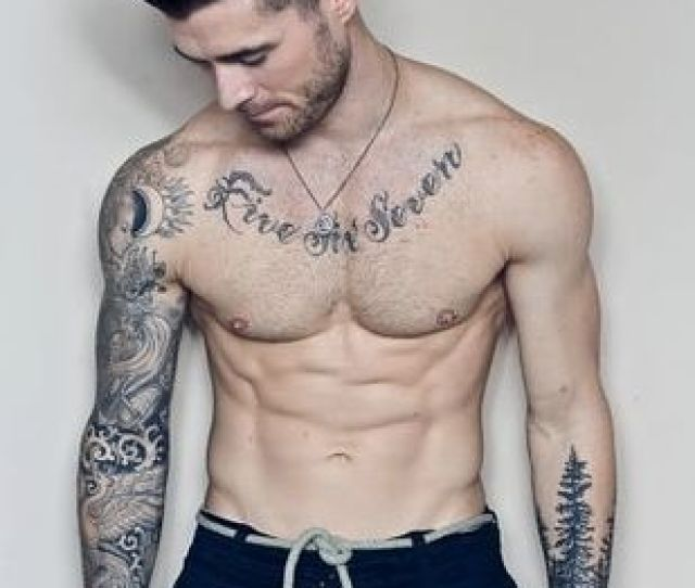The Left Arm Is A Great Example Of Blackwork Style Tattoo Ideas For Men It Showcases A Forest Of Solid Black Pine Trees Circling Around The Lower Arm