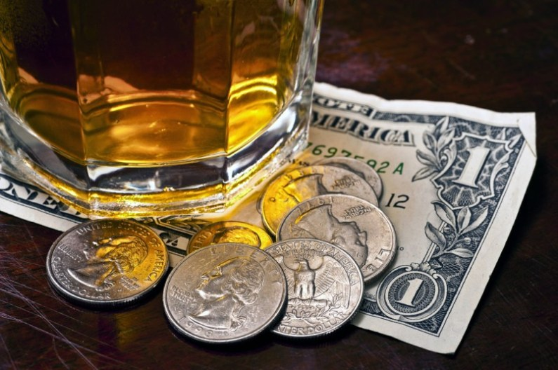 Image result for tip money on the bar