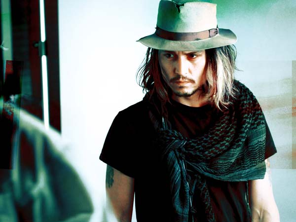 Johnny Depp lover of hats and scarves