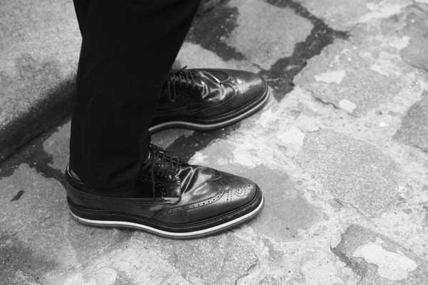 Men wearing funky think brogued shoes - East London