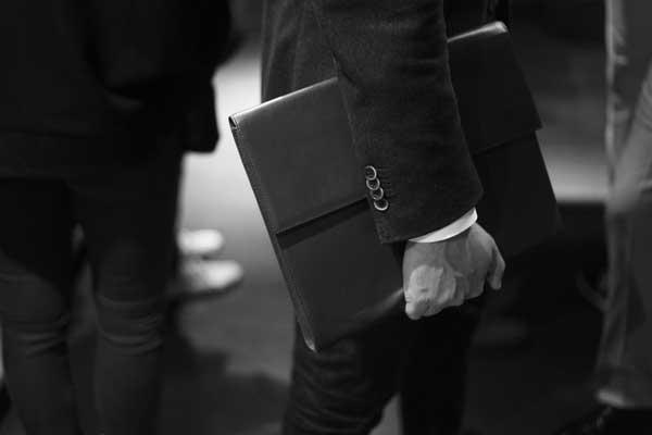 Man walking with slim looking briefcase