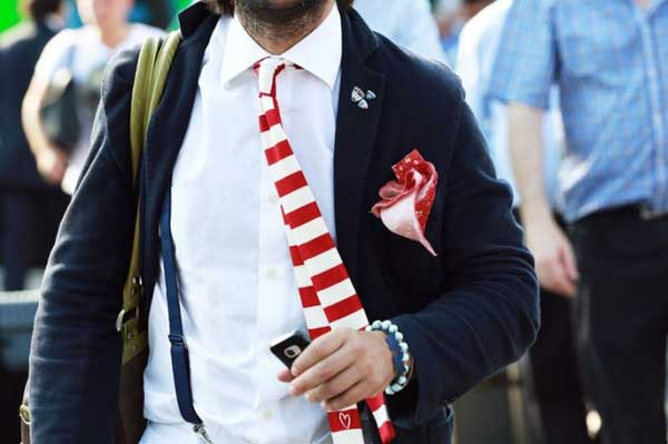 Grey top, striped tie white red