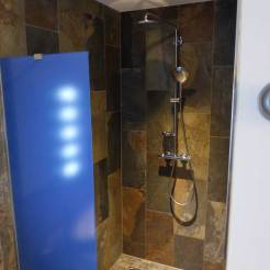Shower with massive shower head