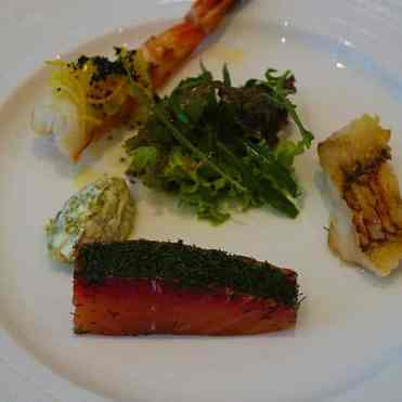 Selected Prawn, Marinated Salmon and fillet of fish with garden greens