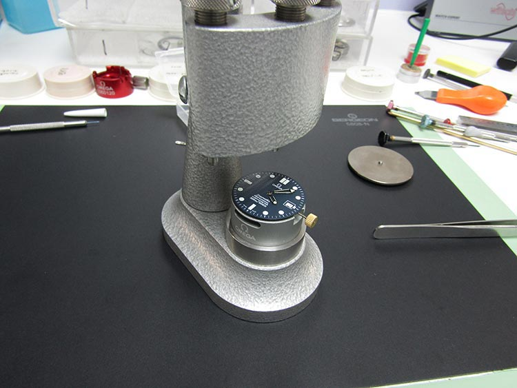 """Fascia is re-attached to the watch, ready to be installed in the case"" Omega Watch"