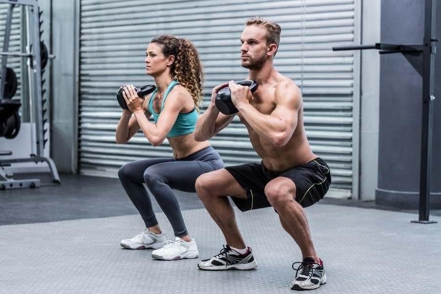 Gym couple exercise