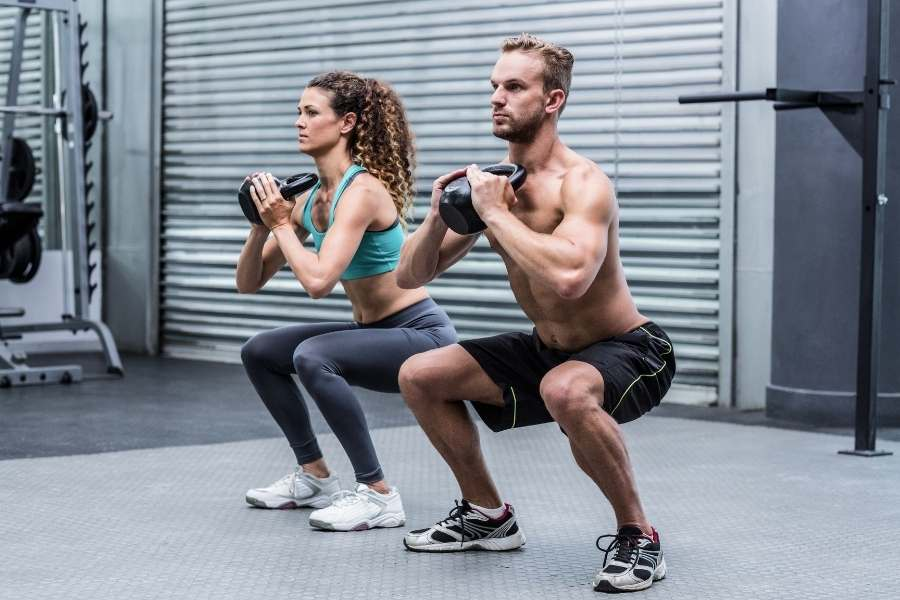 Gym couple exercise