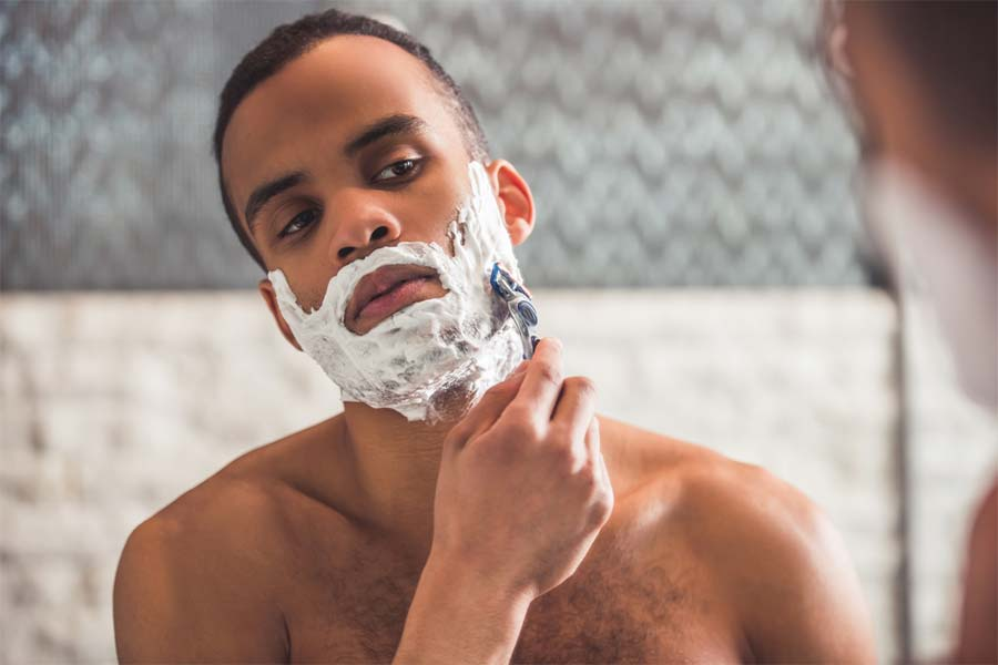 man shaving wet