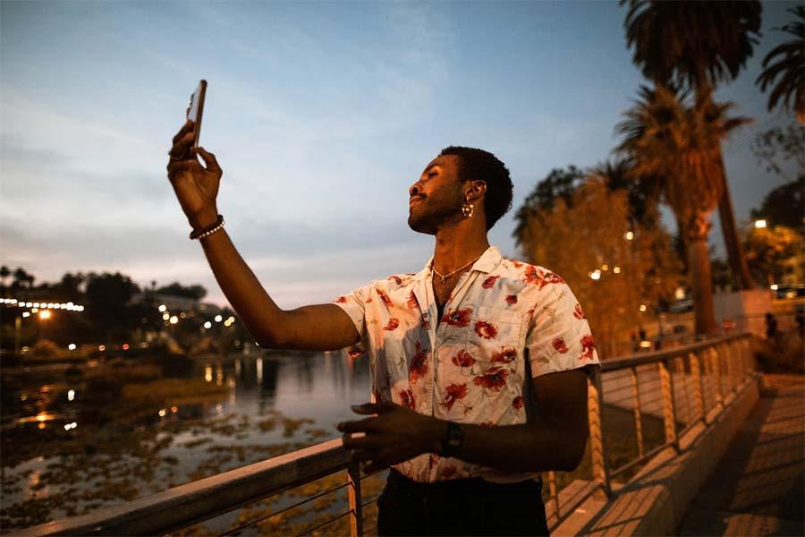 men taking a selfie by night