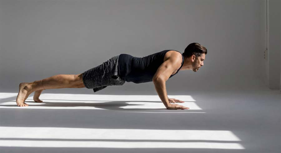 Push ups are another workout that Sean O'pry does to stay in shape