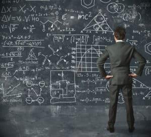 Next? Professor in front of confusing blackboard of ideas