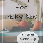 Child's hand reaching for strawberry with text overlay - Top tips for picky kids