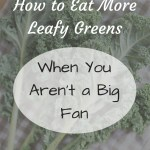 Kale leafs on kitchen towel with text overlay - How to eat more leafy greens when you aren't a big fan