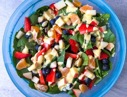 Blue bowl full of greens and fruit