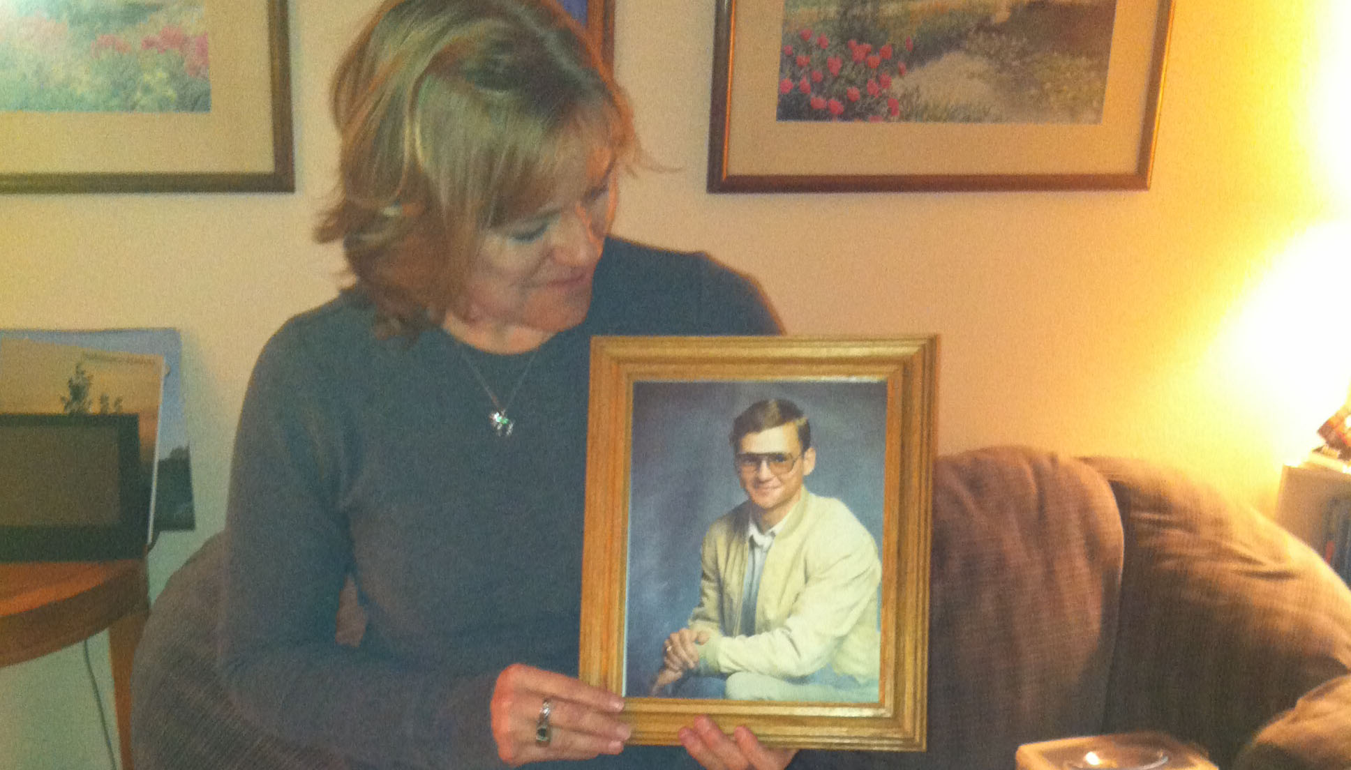 Ronda Hatefi holds a picture of her brother, Bobby, a problem gambler who committed suicide in 1995.
